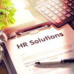 HR Solutions written on clipboard