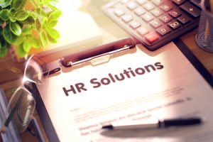 HR Solutions written on clipboard