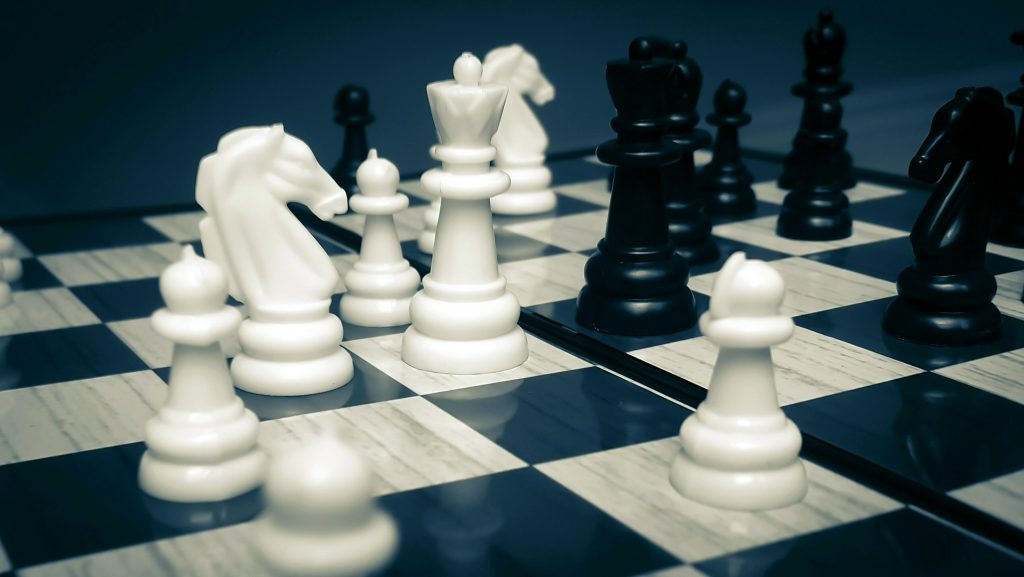 chess pieces dictating the need to be strategic